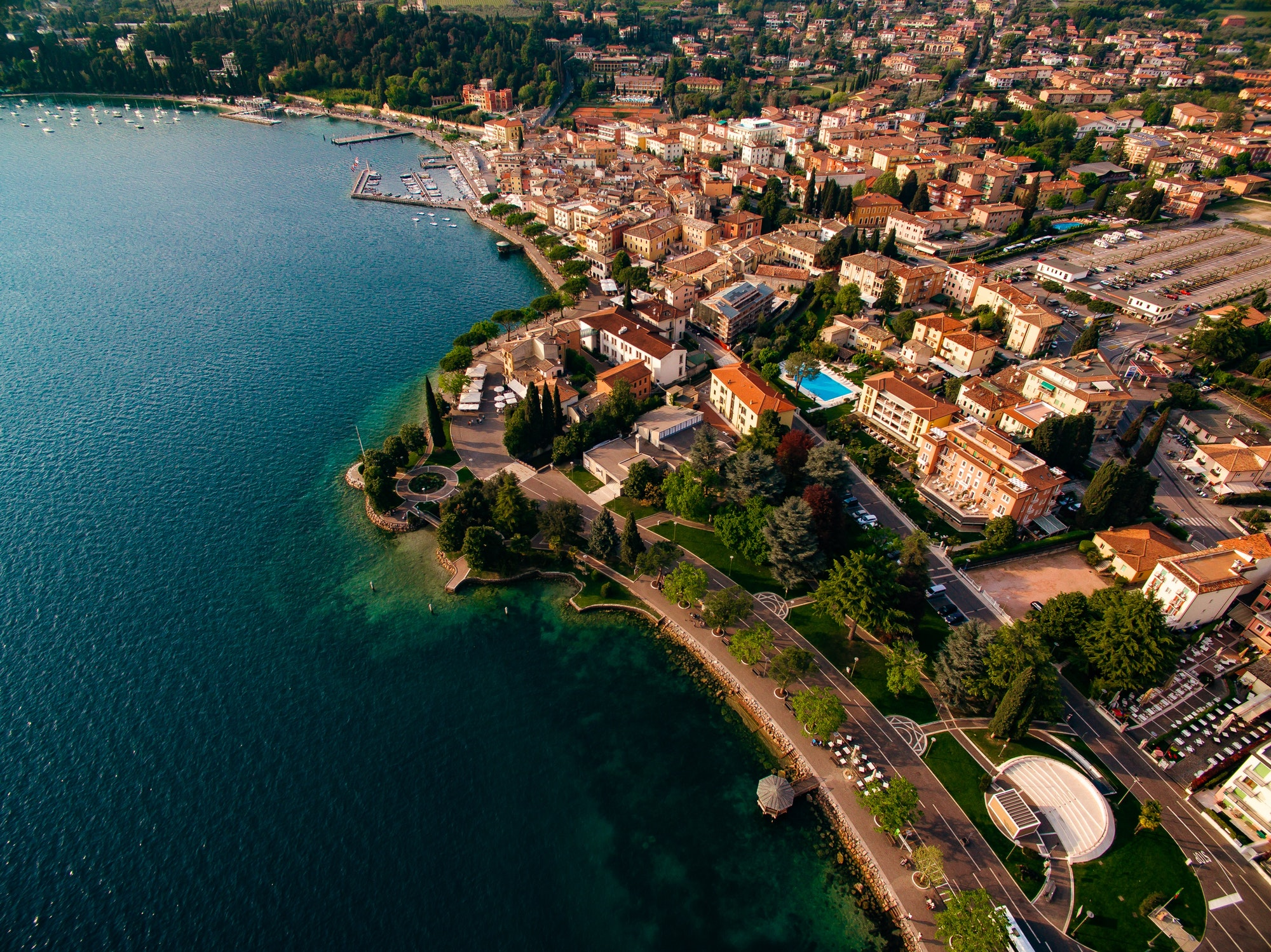 Aerial view of the coast of Lake Garda and a city in Italy.